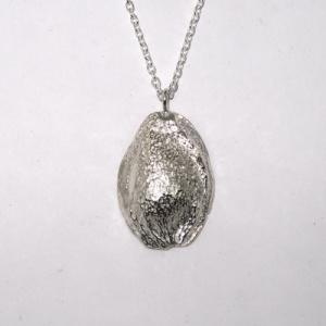 Silver half apricot stone pendant