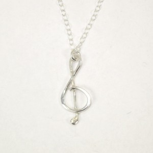 Small treble clef silver pendant