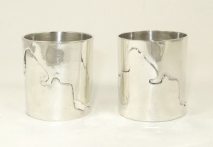 Silver napkin rings showing the Thames Path