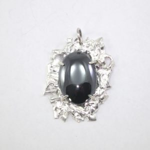 Fused silver pendant with haematite