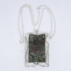 Silver pendant mount for a mineral sample