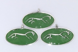 Silver Uffington White Horses on a green background