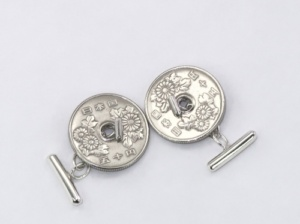Simple silver cufflinks for a coin with a hole at the centre