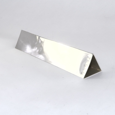 Rear - triangular silver ruler