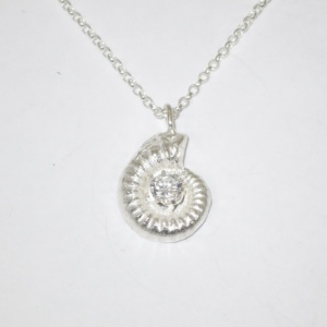 Solid silver ammonite pendant with stone