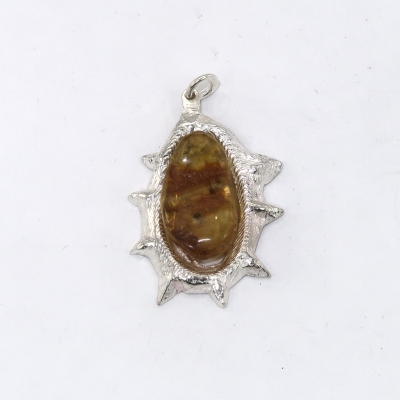 Amber mounted as a silver pendant