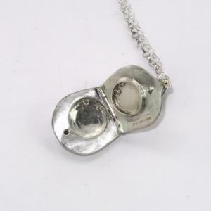 Silver teardrop locket inside