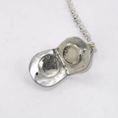 Silver teardrop locket inside