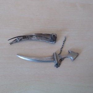 As received silver dagger brooch