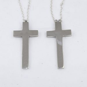 Matched silver cross pendants