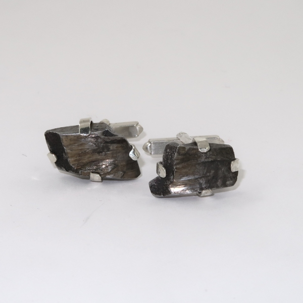 Silver cufflinks from bomb casing fragment