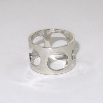Broad silver ring with large holes