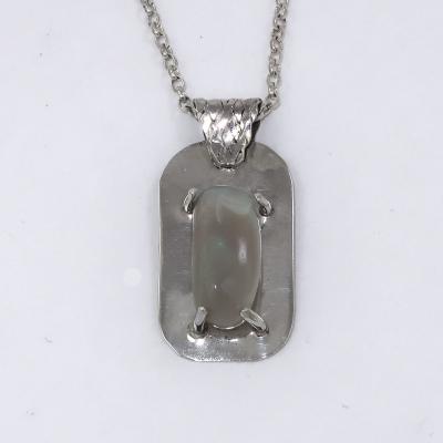 Opal in silver pendant