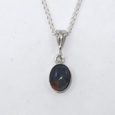 Opal triplet in silver bezel setting
